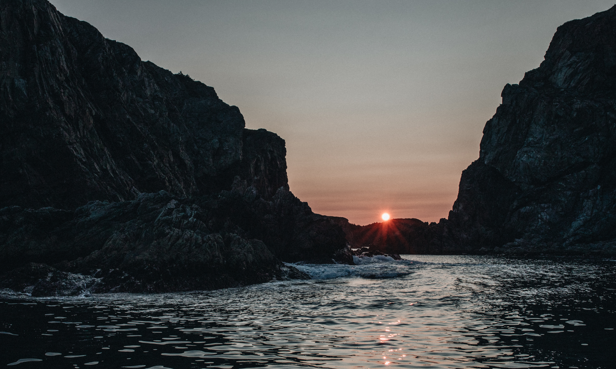 Rocky cliffs, water and sun